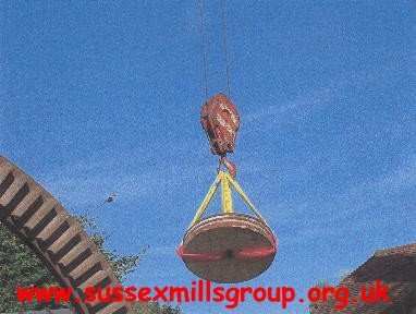 One of the four millstones being raised ready to be lowered into the buck of the mill : [Taken at 10.32 am on 16/9/04]
